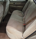ford taurus 2002 gold sedan se gasoline 6 cylinders front wheel drive 4 speed automatic 77532