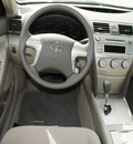 toyota camry 2011 tan sedan le gasoline 4 cylinders front wheel drive automatic 76011