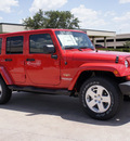 jeep wrangler unlimited 2011 red suv sahara gasoline 6 cylinders 4 wheel drive automatic with overdrive 76011