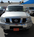 nissan titan 2004 silver gasoline 8 cylinders rear wheel drive automatic 79936