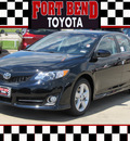 toyota camry 2012 black sedan se gasoline 4 cylinders front wheel drive automatic with overdrive 77469