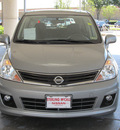 nissan versa 2010 silver hatchback 1 8 sl gasoline 4 cylinders front wheel drive automatic with overdrive 77477