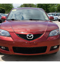 mazda mazda3 2009 dk  red sedan i touring value gasoline 4 cylinders front wheel drive automatic 78729