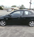 hyundai accent 2009 black hatchback se gasoline 4 cylinders front wheel drive 5 speed manual 13502