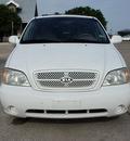 kia sedona 2004 white van lx gasoline 6 cylinders front wheel drive automatic with overdrive 76087
