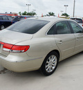 hyundai azera 2009 gold sedan limited gasoline 6 cylinders front wheel drive automatic 76087