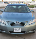 toyota camry 2009 green sedan le gasoline 4 cylinders front wheel drive automatic with overdrive 77074