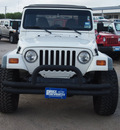 jeep wrangler 1999 white suv sport gasoline 6 cylinders 4 wheel drive 5 speed manual 78064