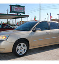 chevrolet malibu 2006 gold sedan lt gasoline 6 cylinders front wheel drive automatic 77504