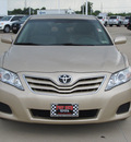 toyota camry 2010 tan sedan le gasoline 4 cylinders front wheel drive automatic with overdrive 77469