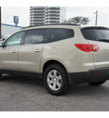 chevrolet traverse 2011 gold lt gasoline 6 cylinders front wheel drive automatic 78216
