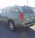gmc envoy 2004 green suv gasoline 6 cylinders rear wheel drive automatic 79922
