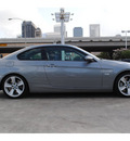 bmw 335i 2009 dk  gray coupe gasoline 6 cylinders rear wheel drive automatic 77002