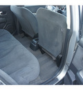 nissan versa 2011 silver hatchback gasoline 4 cylinders front wheel drive automatic 77034