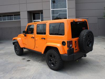 jeep wrangler unlimited 2012 orange suv rubicon gasoline 6 cylinders 4 wheel drive automatic 76108