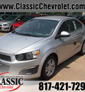 chevrolet sonic 2012 silver ice sedan ls gasoline 4 cylinders front wheel drive 5 speed manual 76051