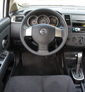 nissan versa 2007 white hatchback s 4 cylinders automatic with overdrive 76087