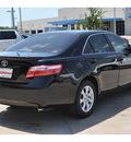 toyota camry 2009 black sedan gasoline 4 cylinders front wheel drive 5 speed manual 78233