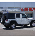 jeep wrangler unlimited 2009 white suv x 6 cylinders automatic 79119