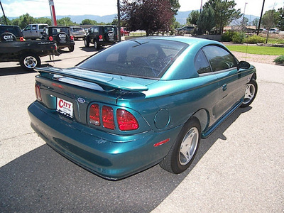 ford mustang 1998 green coupe gasoline v6 rear wheel drive automatic 81212