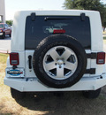 jeep wrangler unlimited 2010 white suv sahara gasoline 6 cylinders 4 wheel drive automatic 75067