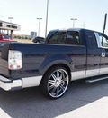 ford f 150 2005 blue xlt gasoline 8 cylinders rear wheel drive automatic with overdrive 76011