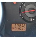 nissan versa 2009 silver sedan 1 6 gasoline 4 cylinders front wheel drive 5 speed manual 78233