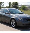 nissan altima 2006 gray sedan 3 5 se gasoline 6 cylinders front wheel drive automatic 77338