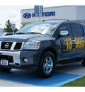 nissan armada 2004 dk  gray suv le 8 cylinders automatic 77094