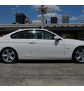 bmw 3 series 2009 white coupe 335i gasoline 6 cylinders rear wheel drive 6 speed manual 77002