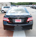 toyota camry 2011 black sedan se v6 gasoline 6 cylinders front wheel drive automatic with overdrive 77706