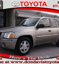 gmc envoy 2003 tan suv sle gasoline 6 cylinders 4 wheel drive automatic 76011