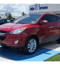 hyundai tucson 2012 dk  red limited gasoline 4 cylinders front wheel drive automatic 77094