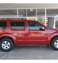 nissan pathfinder 2009 dk  red suv le gasoline 6 cylinders 2 wheel drive automatic 78216