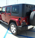 jeep wrangler unlimited 2009 red suv sahara gasoline 6 cylinders 4 wheel drive automatic 76230