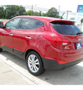 hyundai tucson 2012 dk  red limited gasoline 4 cylinders front wheel drive automatic with overdrive 77627