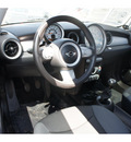 mini cooper 2010 red hatchback gasoline 4 cylinders front wheel drive 6 speed manual 76502