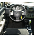 nissan versa 2010 silver hatchback gasoline 4 cylinders front wheel drive automatic with overdrive 76087