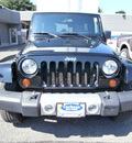 jeep wrangler unlimited 2009 black suv sahara gasoline 6 cylinders 4 wheel drive automatic 13502