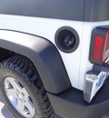jeep wrangler unlimited 2010 white suv rubicon gasoline 6 cylinders 4 wheel drive automatic 77388
