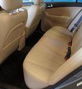 hyundai sonata 2009 tan sedan limited v6 gasoline 6 cylinders front wheel drive automatic 75062