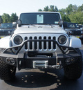 jeep wrangler unlimited 2009 silver suv sahara gasoline 6 cylinders 4 wheel drive automatic with overdrive 07730