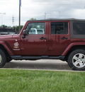 jeep wrangler unlimited 2009 red suv sahara gasoline 6 cylinders 4 wheel drive automatic 77090