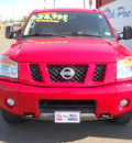 nissan titan 2012 red flex fuel 8 cylinders 4 wheel drive automatic 79925