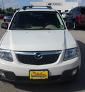 mazda tribute 2009 off white suv i grand touring gasoline 4 cylinders front wheel drive automatic 77802