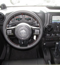 jeep wrangler unlimited 2012 black suv sahara gasoline 6 cylinders 4 wheel drive automatic with overdrive 77099