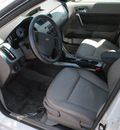 ford focus 2009 white sedan sel gasoline 4 cylinders front wheel drive automatic 91010