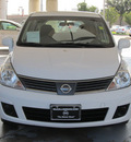 nissan versa 2009 white hatchback 1 8 sl gasoline 4 cylinders front wheel drive automatic with overdrive 77477