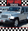 jeep wrangler unlimited 2010 silver suv sahara gasoline 6 cylinders 2 wheel drive automatic with overdrive 77469