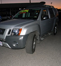 nissan xterra 2010 silver suv gasoline 6 cylinders 4 wheel drive automatic 79925
